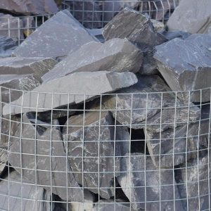 a crate of 70 blue slate rocks