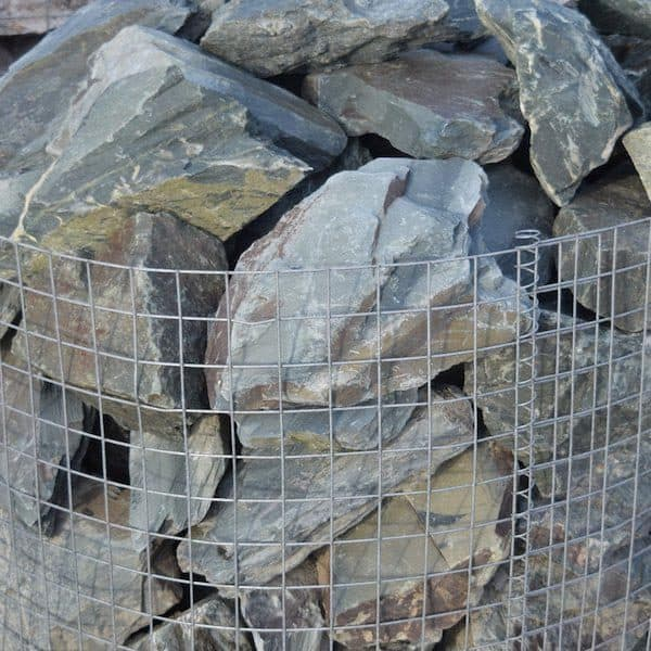 a zoomed-in image of a crate of 70 green slate rocks