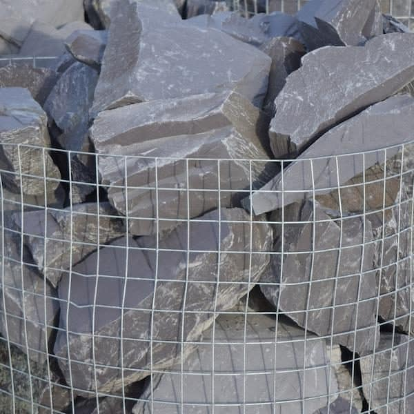 a zoomed-in image of a crate of 70 plum slate rocks