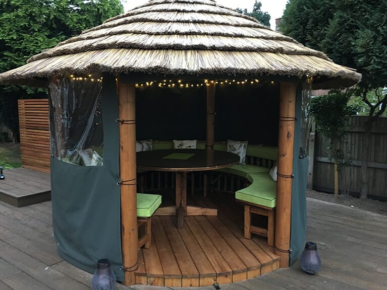 All Weather Pagoda with Decking and Olive Tree