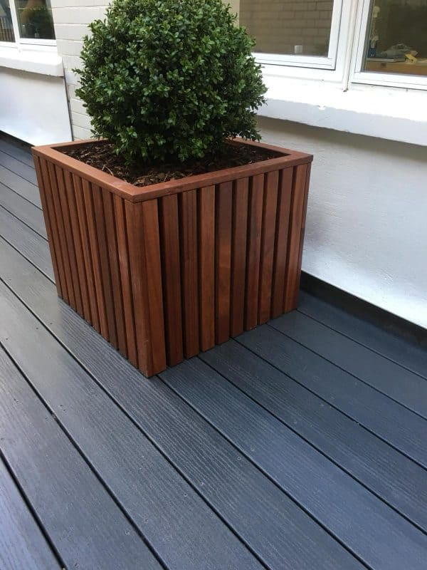 An image of a raised bed on decking.