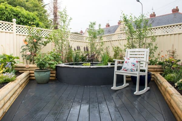 An image of a garden on top of decking.
